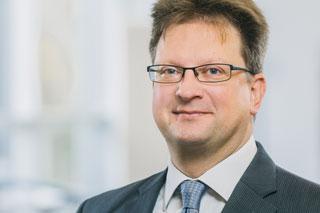 Portrait Markus Gillar, Mann mit Brille